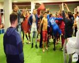 Jogadores do Caxias comemoram acesso à elite do Gauchão no vestiário