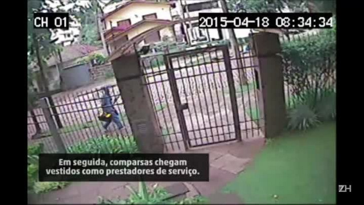 Câmeras registram assalto a prédio residencial