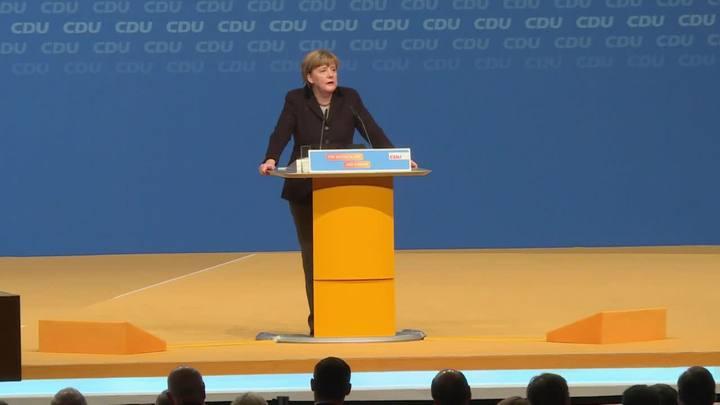 Merkel promete reduzir número de refugiados
