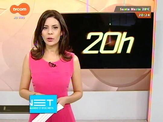 TVCOM 20 Horas - Primeira leva de haitianos que vieram do Acre desembarcam na rodoviária de Porto Alegre - 27/11/2014