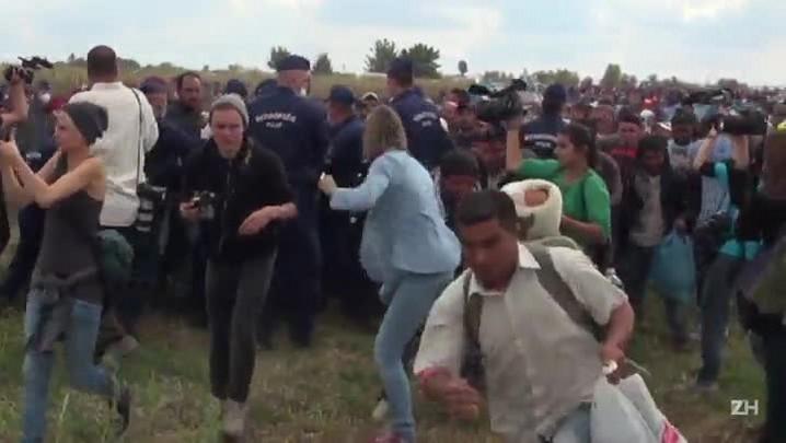 Imagens de cinegrafista chutando migrantes chocam o mundo
